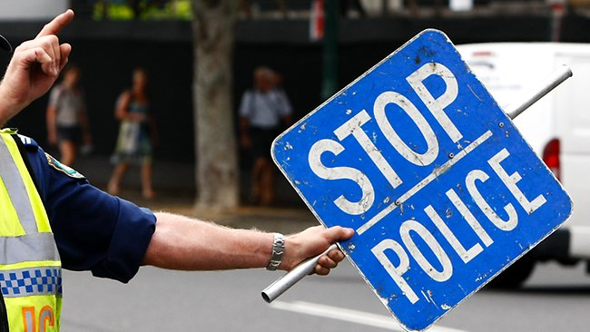 Stop Police sign with Policeman